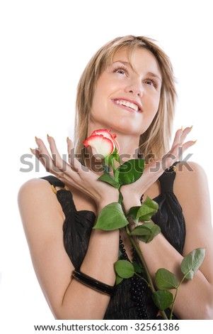 Portrait of the beautiful girl in a black dress with a rose