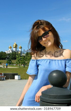 Portrait of the beautiful girl in a park   - stock photo