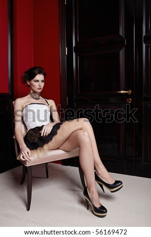 Portrait of the beautiful girl in an interior - stock photo