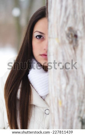 Portrait of the beautiful girl in winter forest. - stock photo