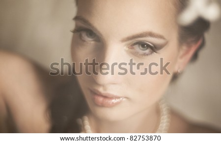 Portrait of the beautiful girl of the bride with soft light - stock photo
