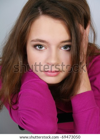 Portrait of the beautiful girl of the teenager with dark hair