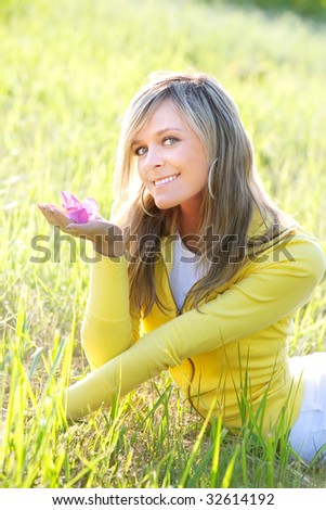 Portrait of the beautiful girl  on a grass - stock photo