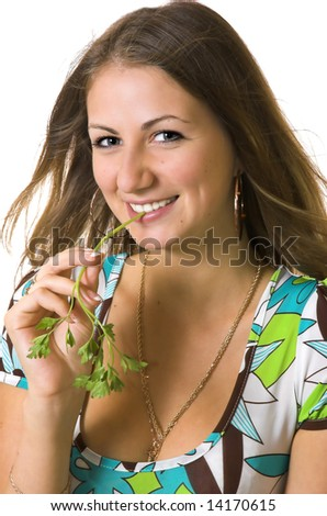 Portrait of the beautiful girl with a stalk of a parsley