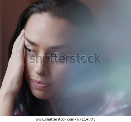 Portrait of the beautiful girl with a thoughtful sight - stock photo