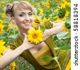portrait of the beautiful happy girl with a sunflowers - stock photo
