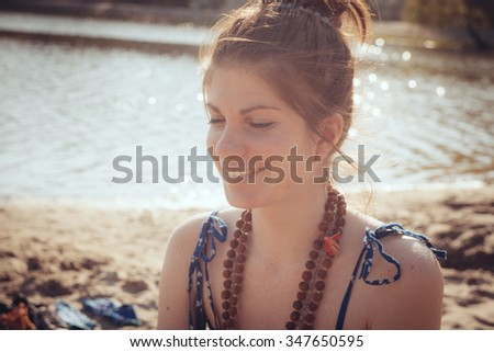 Portrait of the beautiful  hippie style dressed girl close-up, the wind fluttering hair. - stock photo