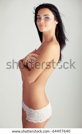 Portrait of the beautiful naked woman - stock photo