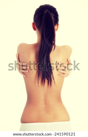 Portrait of the beautiful naked woman back