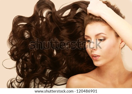 Portrait of the beautiful nice woman with long hair