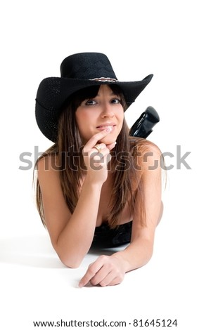 Portrait of the beautiful sexual girl of the brunette in stetson on white background