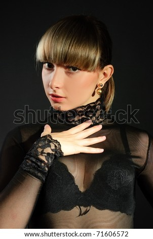 Portrait of the beautiful sexual girl to blonde close-up on gray background