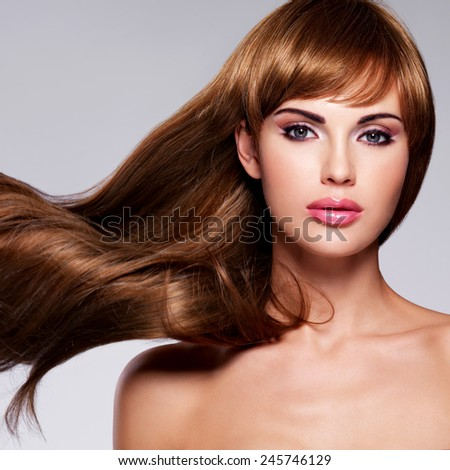 Portrait of the beautiful sexy woman with long  hair. Fashion model with straight hairstyle - stock photo