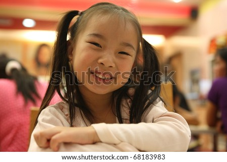Portrait of the beautiful small Asian girl kid in the ice cream shop. Lampang Thailand - stock photo