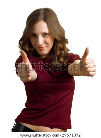 """Portrait of the beautiful smiling girl showing """"Thumbs up"""". Isolation on a white background. Focus on hands. - stock photo"""