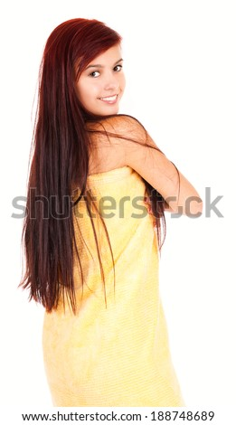 portrait of the beautiful teen woman in towel, white background - stock photo