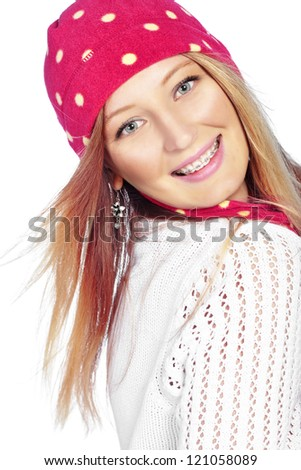 Portrait of the beautiful teenage girl wearing warm winter clothing - stock photo