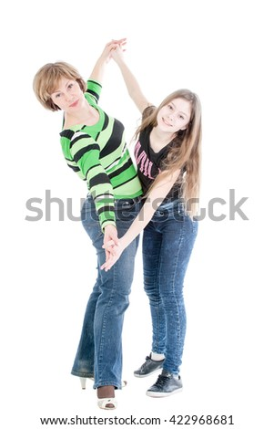 portrait of the beautiful woman and young girl in the movement on a white background - stock photo