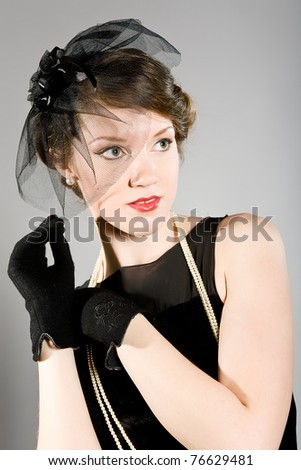 Portrait of the beautiful woman in an elegant hat - stock photo