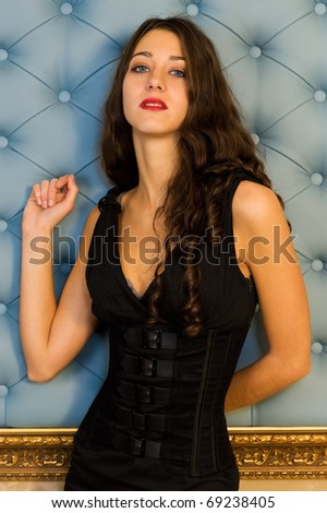 Portrait of the beautiful woman in black gown - stock photo