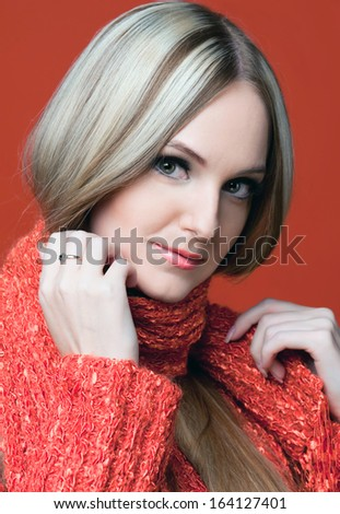 Portrait of the beautiful woman in red with very long hair.