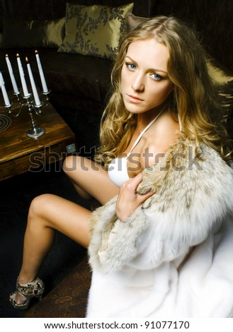 Portrait of the beautiful woman in the luxurious interior - stock photo