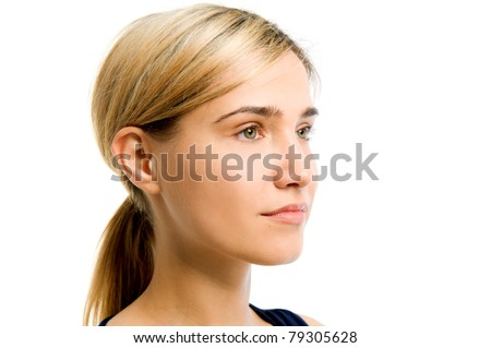 Portrait of the beautiful woman. Looking to the right side. Face without cosmetic