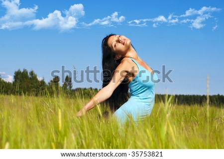Portrait of the beautiful woman on the rye field