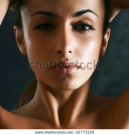 Portrait of the beautiful woman who have clasped a head by hands
