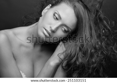 Portrait of the beautiful woman with long hair. Torso portrait.