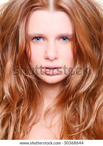 Portrait of the beautiful woman with red hair. - stock photo