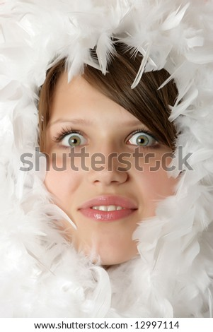 Portrait of the beautiful young girl in a boa