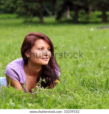 Portrait of the beautiful young girl in the spring in park
