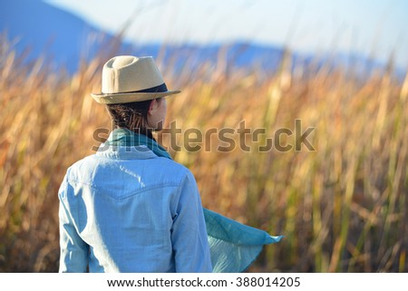 Portrait of the beautiful young lady walking in nature on sunny summer day. - stock photo