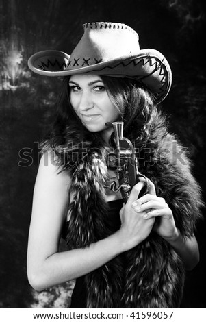 portrait of the beautiful young woman in a hat. black-and-white image