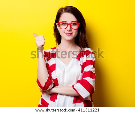 portrait of the beautiful young woman on the yellow background