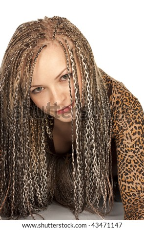 Portrait of the beautiful young woman with dreadlocks on a white background - stock photo