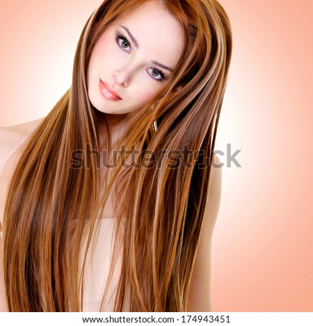 portrait of the beautiful young woman with long straight hairs - stock photo