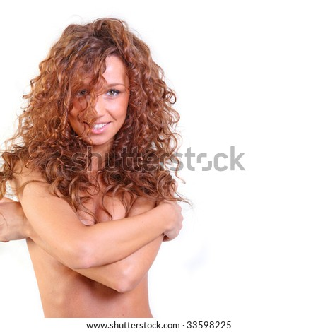 Portrait of the beautiful young woman with magnificent red hair - stock photo