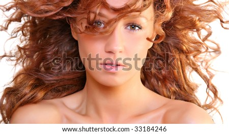 Portrait of the beautiful young woman with magnificent red hair, isolated on a white background, please see some of my other parts of a body images