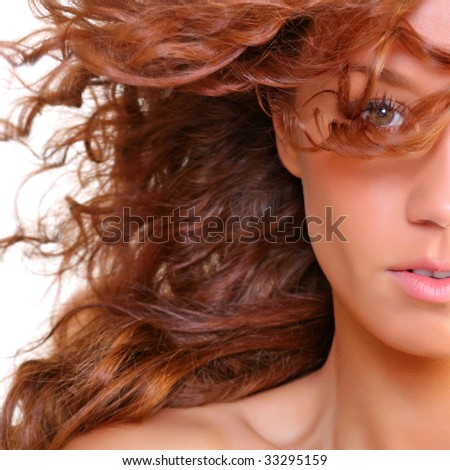 Portrait of the beautiful young woman with magnificent red hair, isolated on a white background, please see some of my other parts of a body images - stock photo