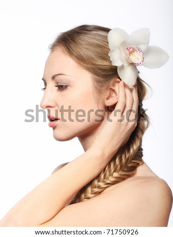 Portrait of the beauty young blond girl with orchid in her hair - stock photo