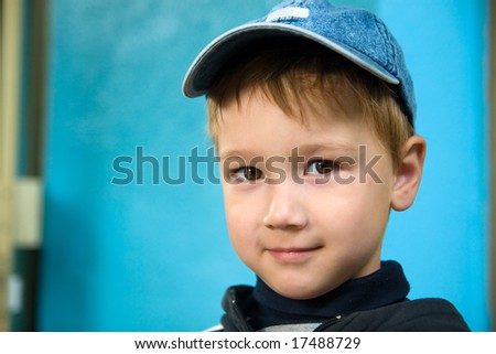 Portrait of the boy in a jeans cap - stock photo