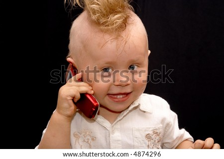Portrait of the boy speaking on a cellular telephone