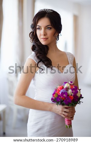 Portrait of the bride with a bouquet of flowers