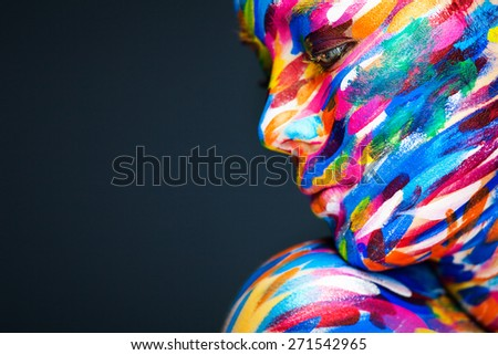 Portrait of the bright beautiful young woman with art make-up - stock photo