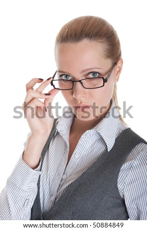 Portrait of the business girl looking from under glasses. Isolated on white background
