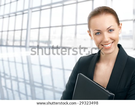 Portrait of the business woman against office space - stock photo