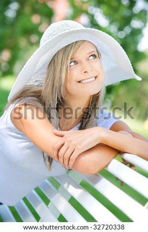Portrait of the charming blonde in a white hat - stock photo