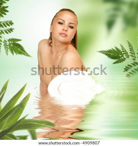portrait of the charming woman in water with reflection - stock photo
